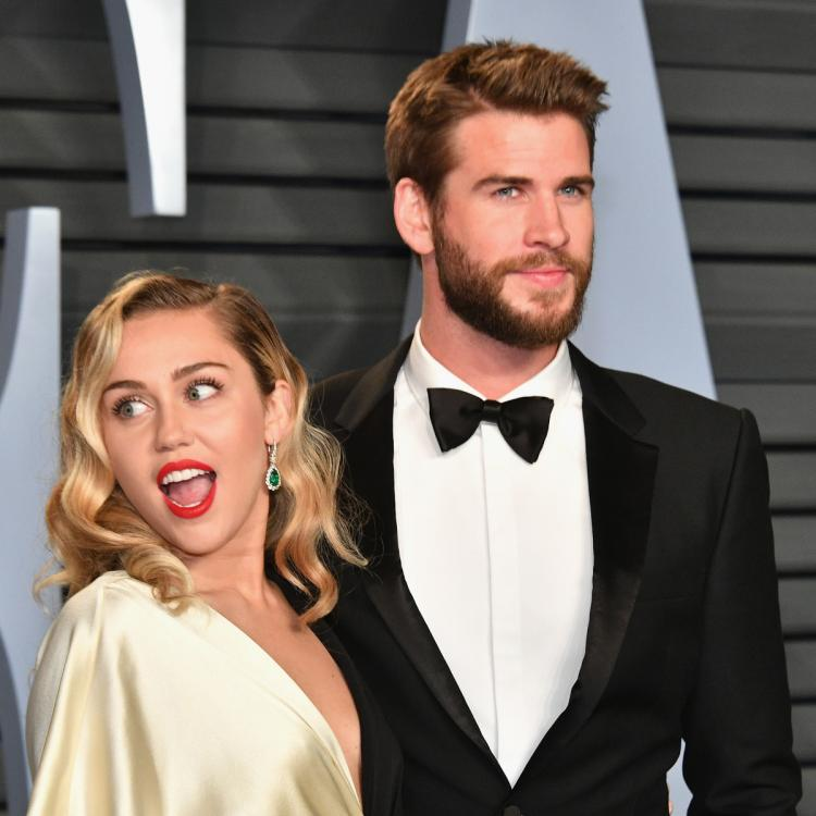 Here's how Liam Hemsworth is reportedly in a 'better place' one year after he & Miley Cyrus headed for divorce