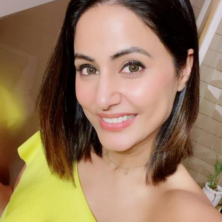 Hina Khan looks every bit stunning as she slays in a yellow one shoulder outfit; See PHOTOS