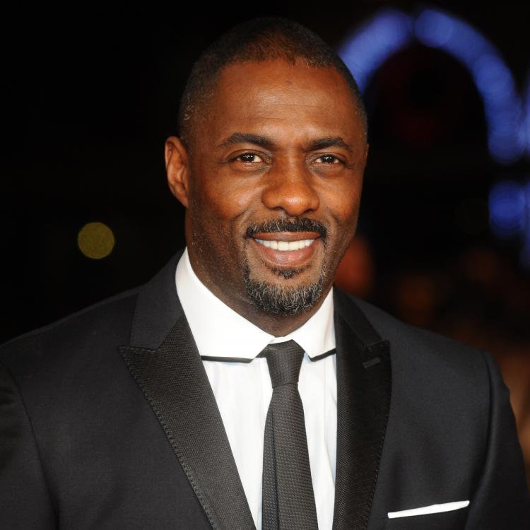 Idris Elba believes racist content in shows and movies should come with a warning instead of banning it