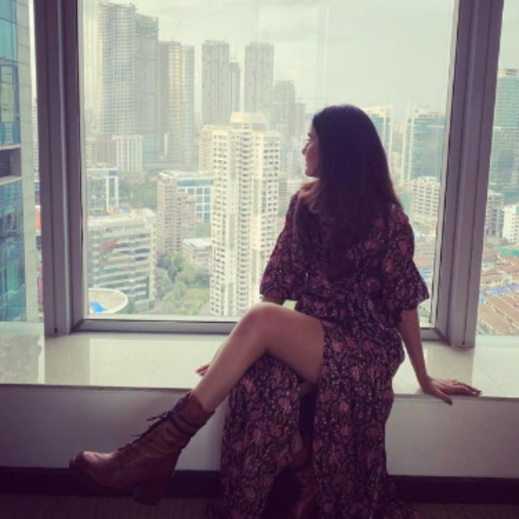 Jasmin Bhasin strikes a candid pose as she enjoys a view of the outside world; See PHOTO
