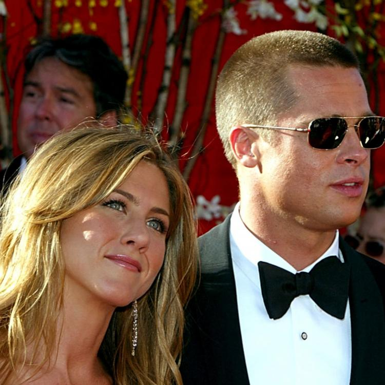 Brad Pitt & Jennifer Aniston are back together and they announced their reunion at the pre Christmas party?