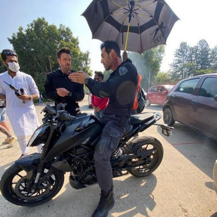 Image result for John Abraham Shoots For An Ultimate Car Chasing Sequence On His Sports Bike But Fans Ask 'Where Is Your Helmet?
