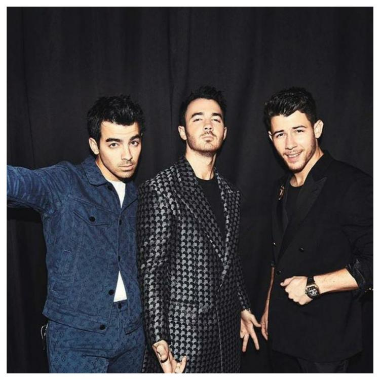 Jonas brothers accused on social media of being mean to a black woman