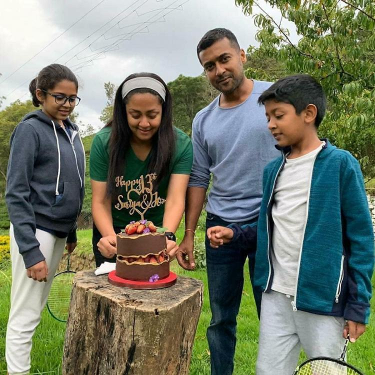 Suriya and Jyothika celebrating their wedding anniversary by cutting a cake makes for an adorable picture