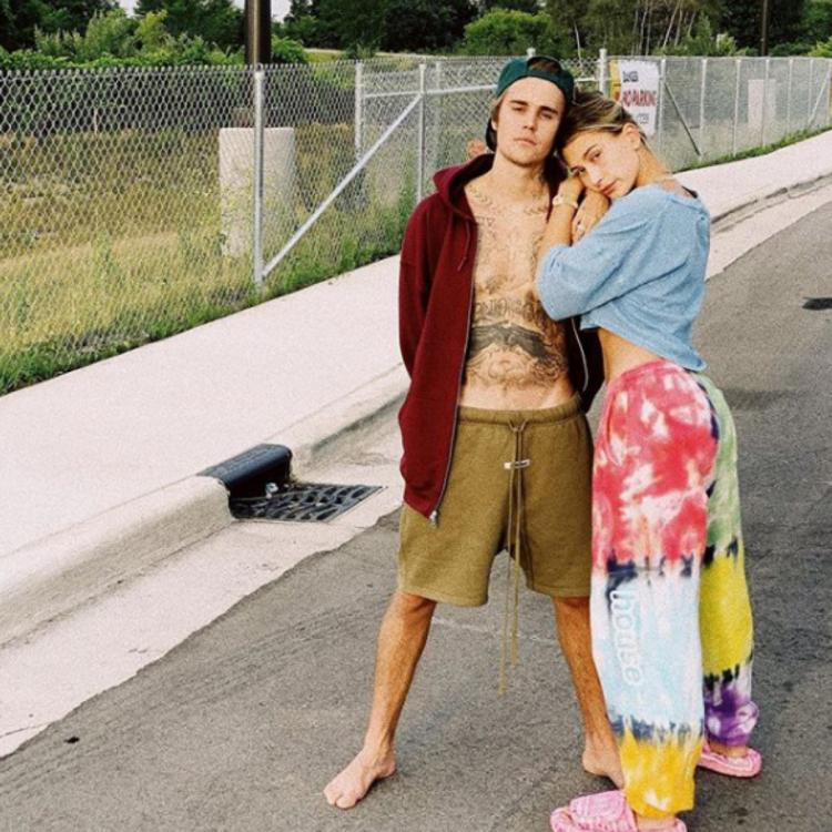 Justin Bieber flaunts tattooed bare chest during a road trip with Hailey: Grateful to be making these memories