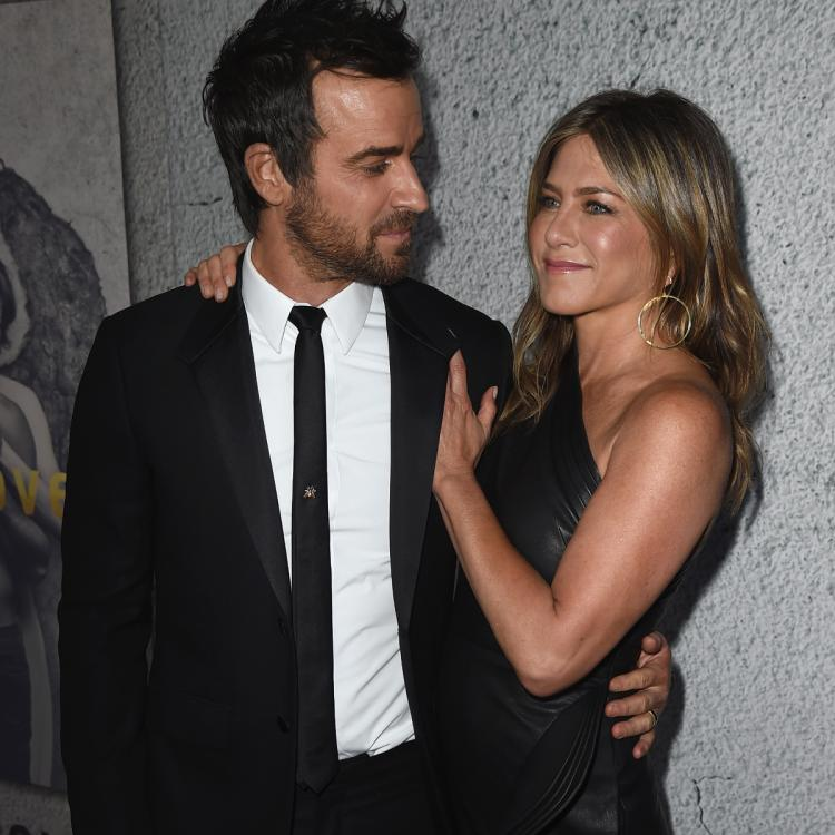 """Justin Theroux confessed that he and Jennifer Aniston do """"check in."""""""