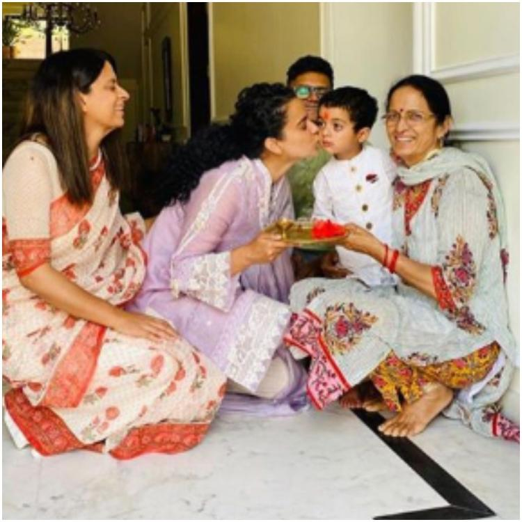 Kangana Ranaut celebrates nephew Prithvi's first visit to Rangoli's new house with kisses & sweets; See PHOTOS
