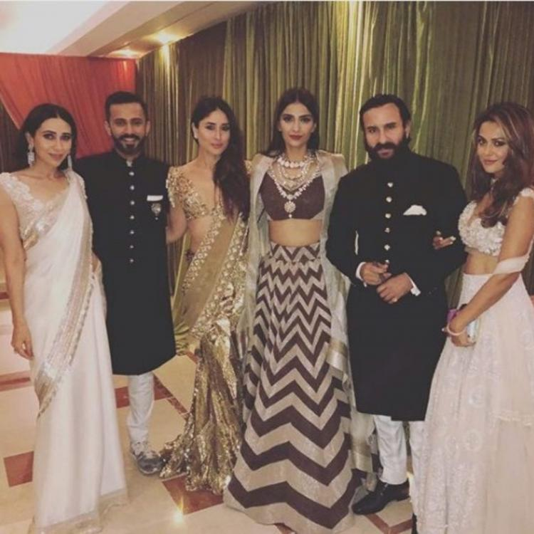 Kareena Kapoor Khan, Saif Ali Khan posing with Sonam & Anand at the duo's reception is fashion personified
