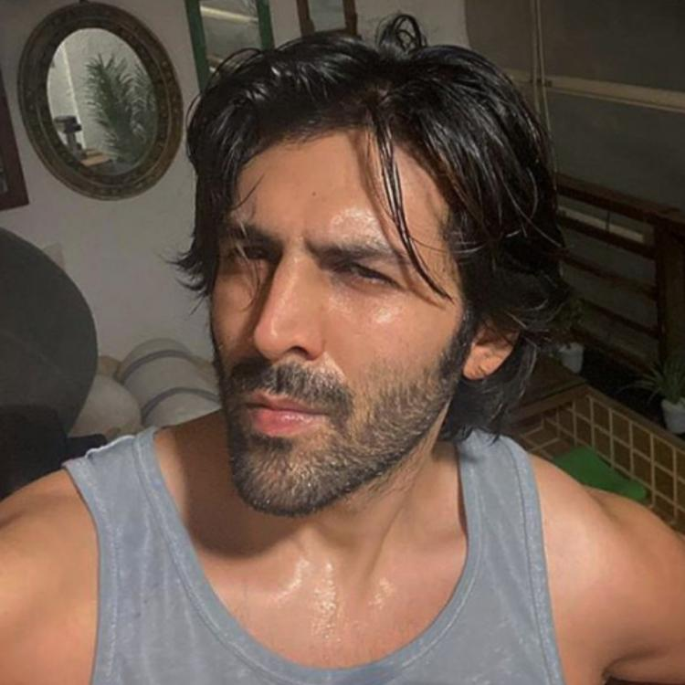 Kartik Aaryan showing off his sweaty look after working out in the night.