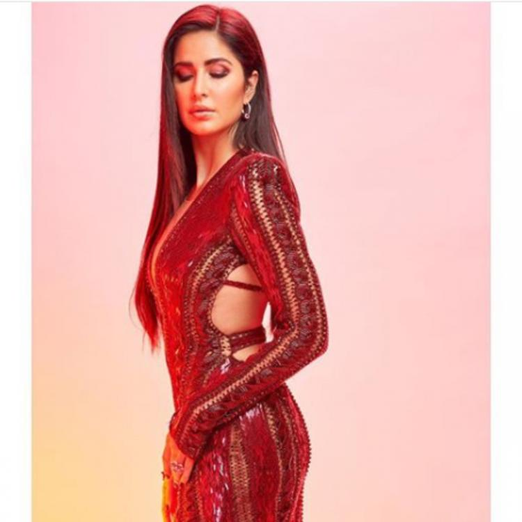 Katrina Kaif does the thigh high slit and the plunging neckline right in a maroon gown; View PICS