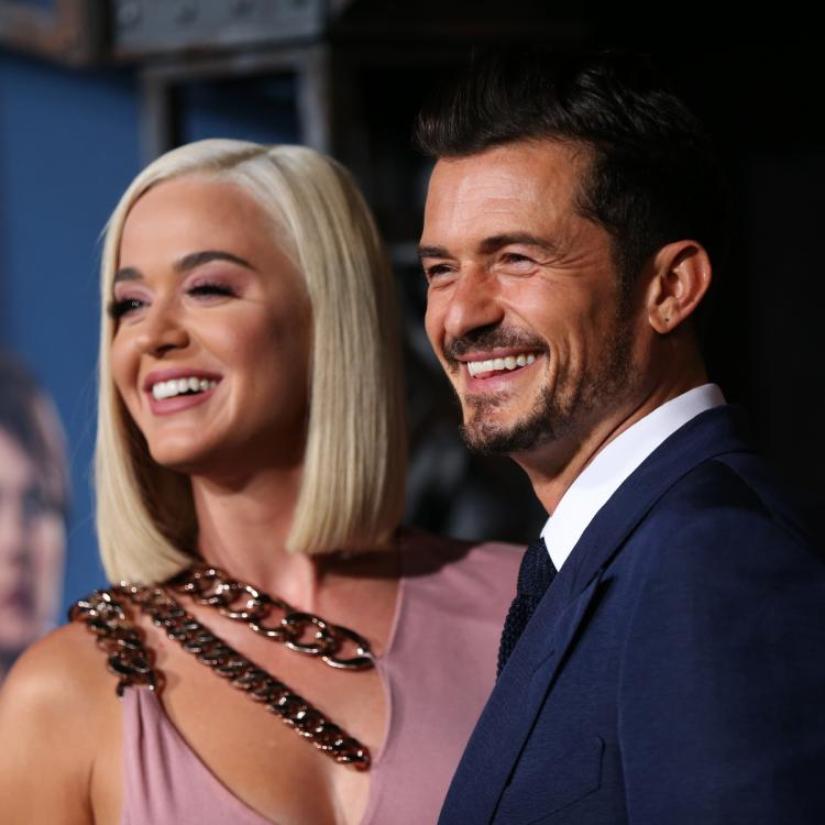 Katy Perry & Orlando Bloom perform while urging fans to vote