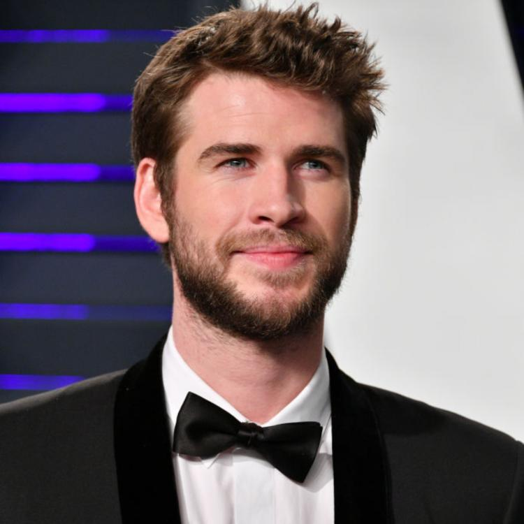 Liam Hemsworth unwinds with Chris Hemsworth while Miley Cyrus deals with Cody Simpson break up rumours