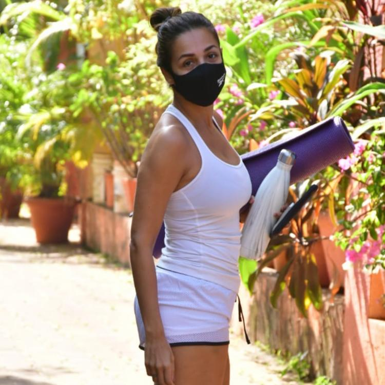 PHOTOS: Malaika Arora kicks off her week with yoga as she poses for the paparazzi in an all white look