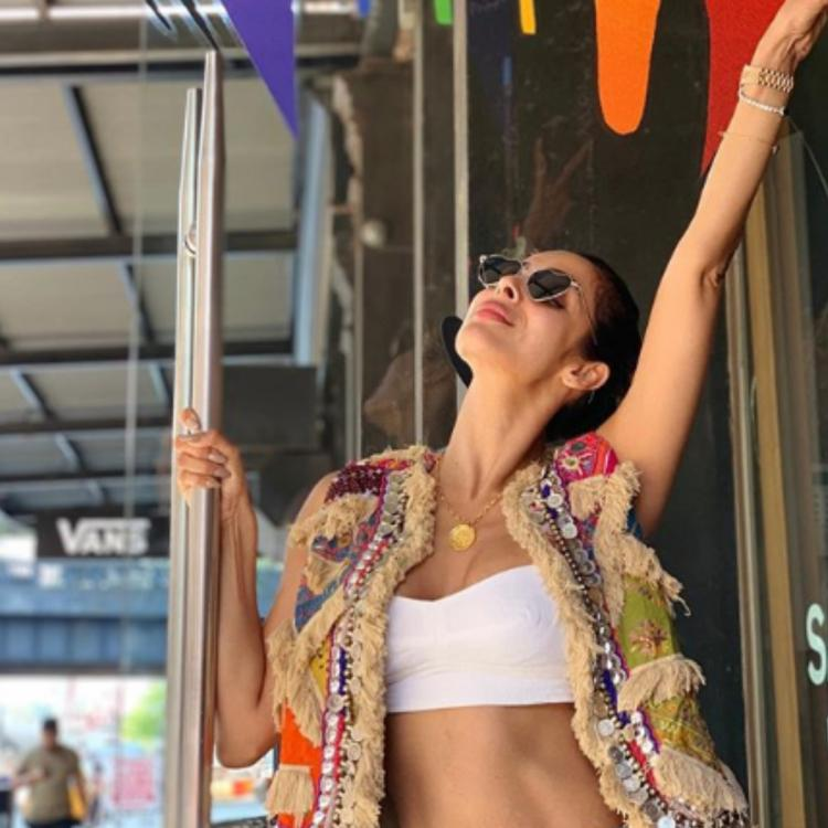 Arjun Kapoor is asking for 'photo credits' while Malaika Arora poses a picture on the streets of NYC