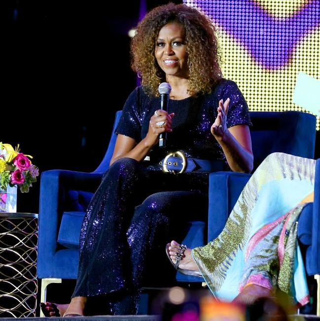 Michelle Obama glittered in a sequin jumpsuit by Sergio Hudson at the Essence Festival