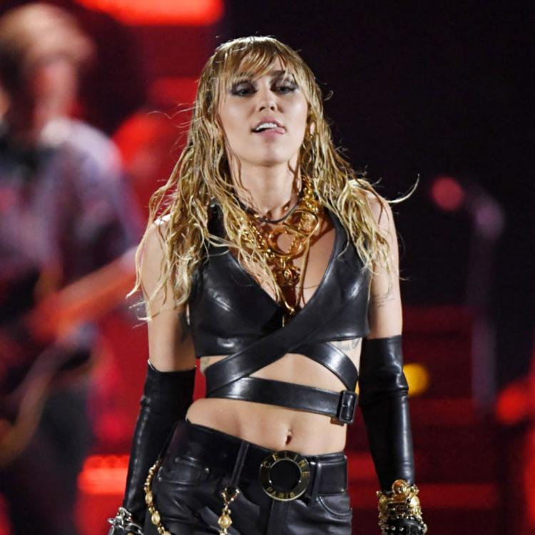 Miley Cyrus says her father Billy Ray Cyrus is not great with using his iPhone