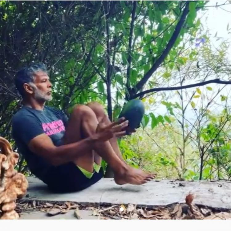Milind Soman exercise with watermelon