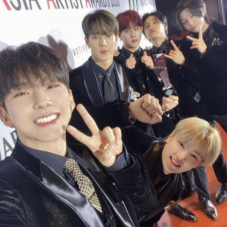 MONSTA X members pose on the red carpet