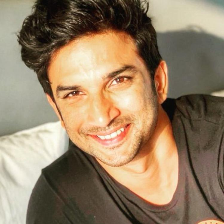 Sushant Singh Rajput smiling in sunkissed photo.