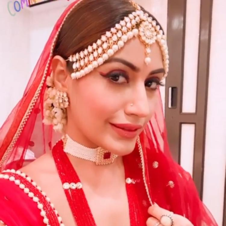 Naagin 5 fame Surbhi Chandna is all decked up in red as she strikes a stunning pose for the camera; See PHOTO