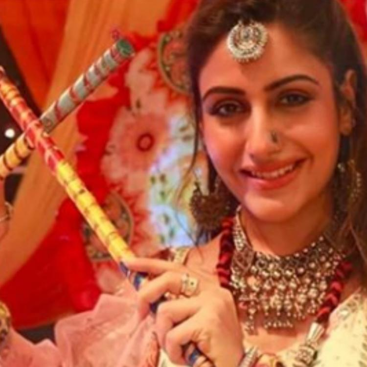 Surbhi Chandna, Sharad Malhotra enjoy Navratri on Naagin 5 sets.