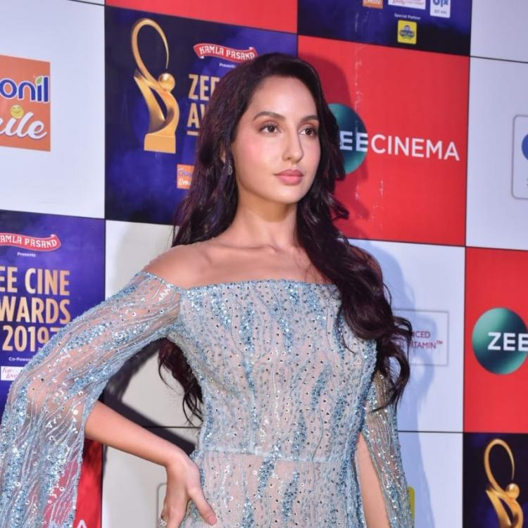 Zee Cine Awards 2019: Sunny Leone looks stunning in a mauve gown, Nora Fatehi shines in a blue attire