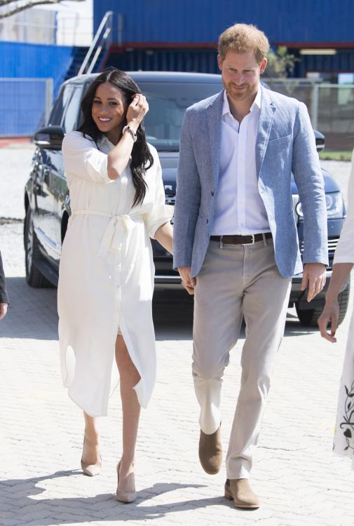 photos prince harry meghan markle are all smiles as they reunite for the last day of their africa royal tour pinkvilla photos prince harry meghan markle are
