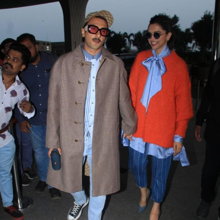 PHOTOS: Birthday girl Deepika Padukone is all smiles while holding hubby Ranveer Singh's hand at the airport