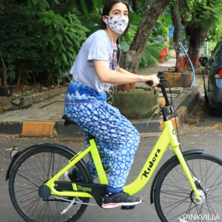 PHOTOS: Sara Ali Khan ditches home workout and opts to cycle on Saturday eve with her mask and headphones on