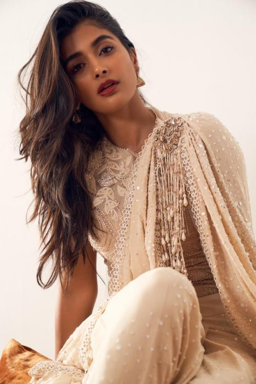 Pooja Hegde channels her inner desi girl in an embellished ivory saree