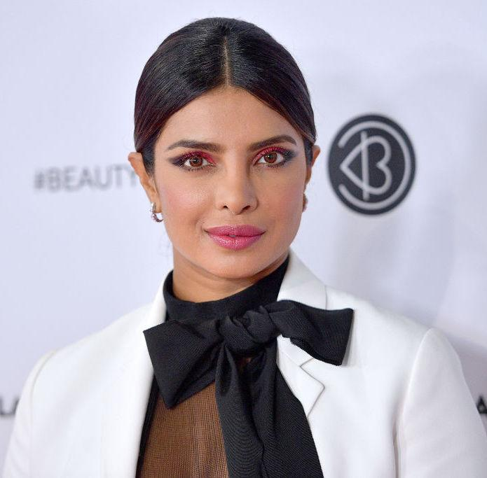 Priyanka Chopra Jonas gave a racy spin to the classic pantsuit and wore the poppiest makeup EVER