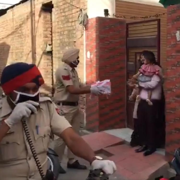 Punjab Police surprises a baby with cake on his first birthday amid lockdown & their gesture is winning hearts