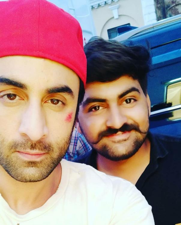 Ranbir Kapoor looks bruised as he clicks a selfie with a fan while shooting for Brahmastra in Varanasi