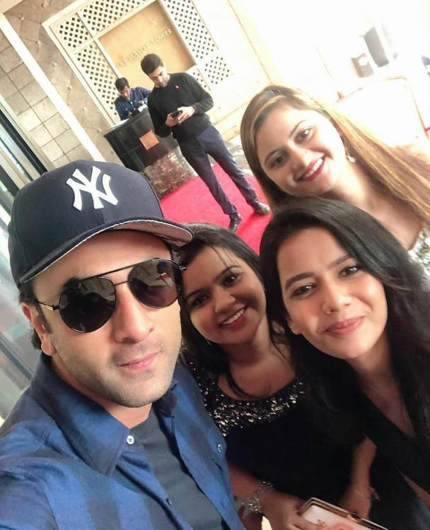 Ranbir Kapoor clicks a selfie with his girl fans and we are totally crushing on him; Take a look