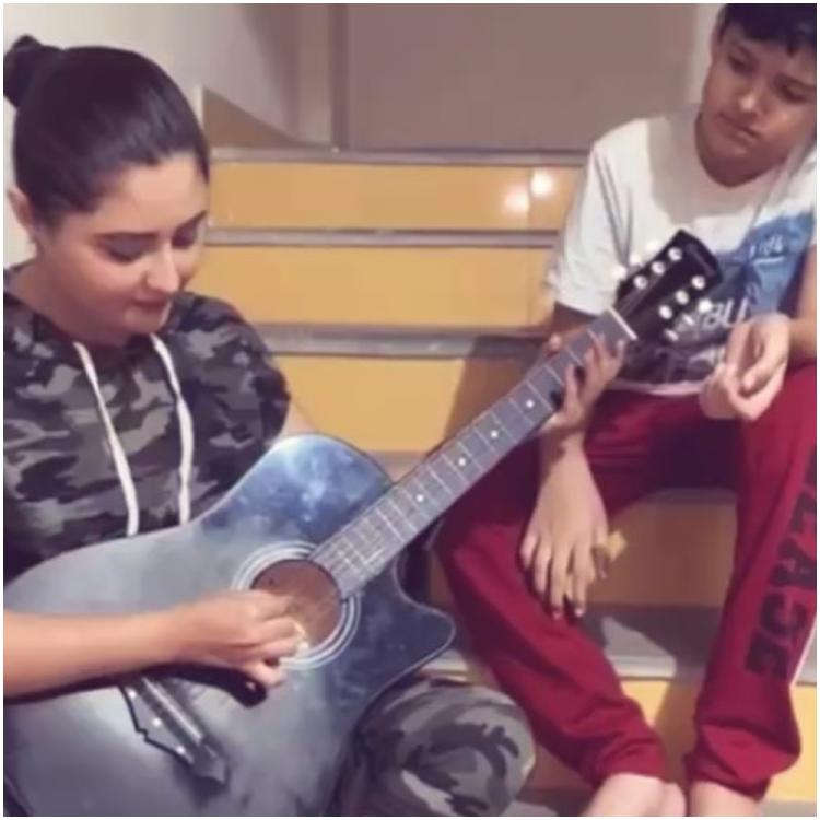 Rashami Desai tries her hand at guitar amid COVID 19 lockdown and gives a valuable advice to her fans; WATCH