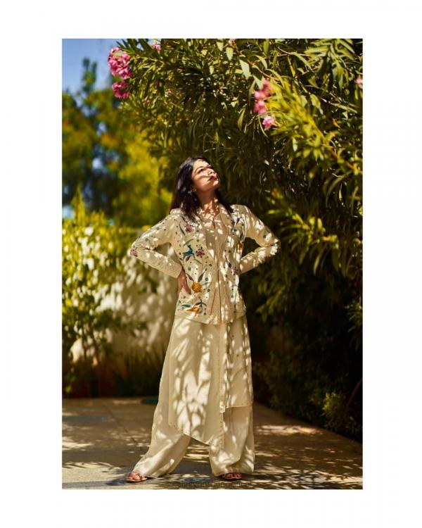 Rashmika Mandanna plays with sunlight in a contemporary desi outfit with a floral blazer