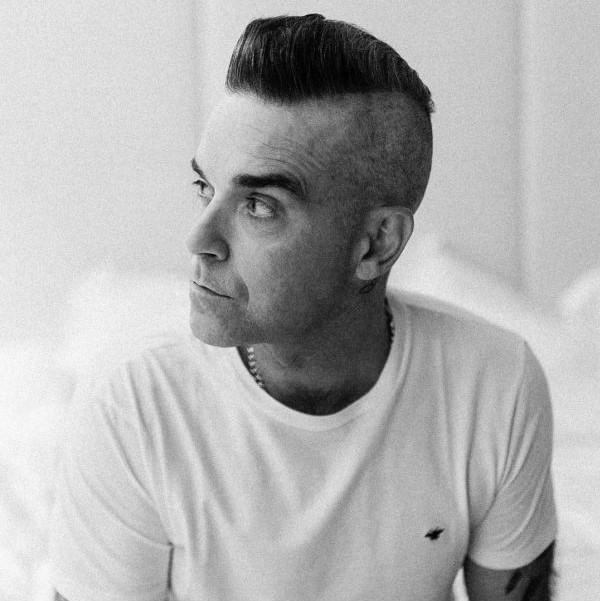 Robbie Williams remembers his wild days of gaining weight