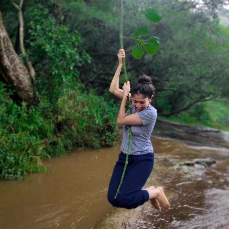Sai Pallavi has a fun time as she swings from aerial roots across a river; See photos