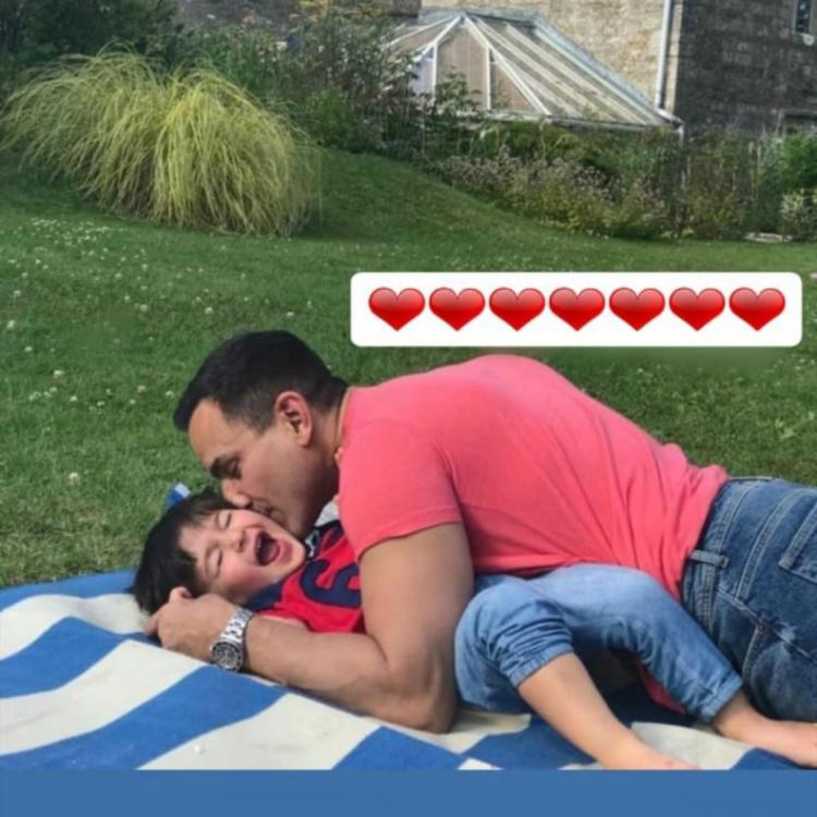 Saif Ali Khan smothering little Taimur Ali Khan with kisses makes for a super happy picture; check it out