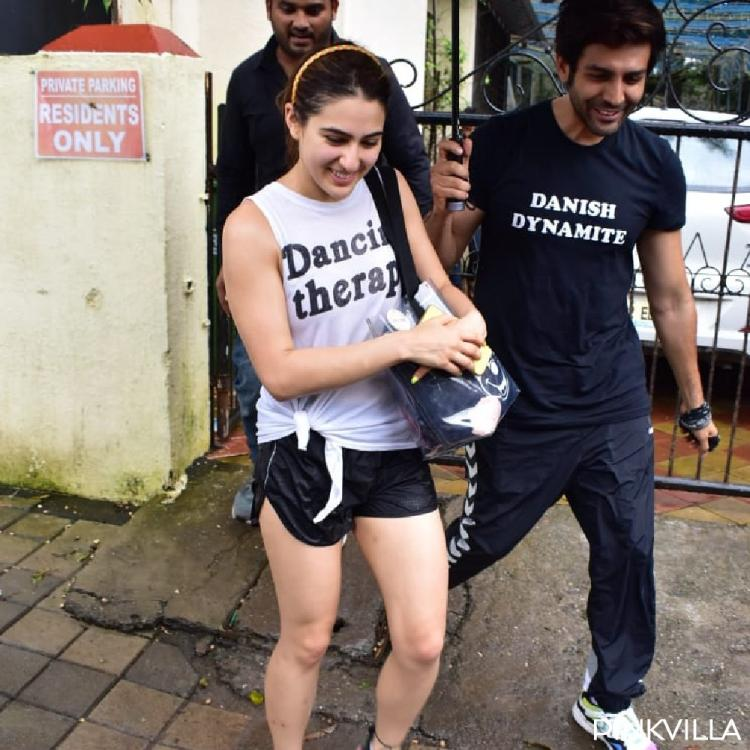 Kartik Aaryan holding an umbrella for Sara Ali Khan is the most adorable thing on the internet; View Pics