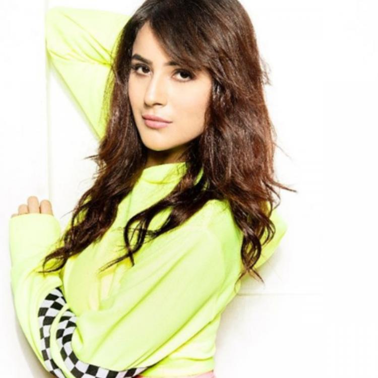 Shehnaaz Gill looks chic in a neon green sporty crop top & denim; Fans cannot stop crushing on her; See Photo