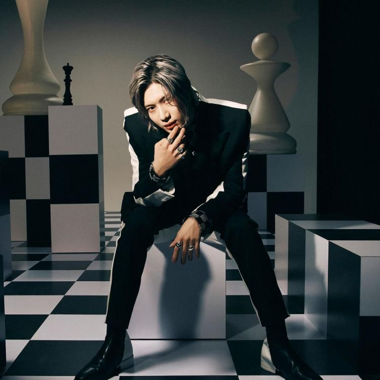 SHINee's Taemin sitting on a giant chessboard, as his concept teaser poster for upcoming album, Advice