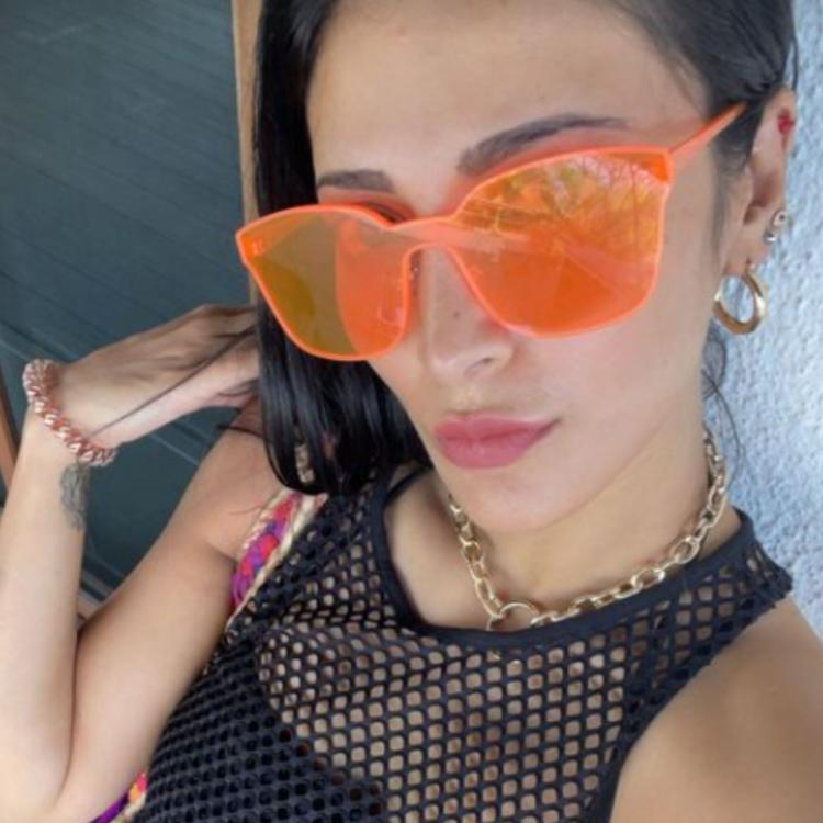 Shruti Haasan is the ultimate beach babe as she flaunts neon glasses & chic outfit; See PHOTOS