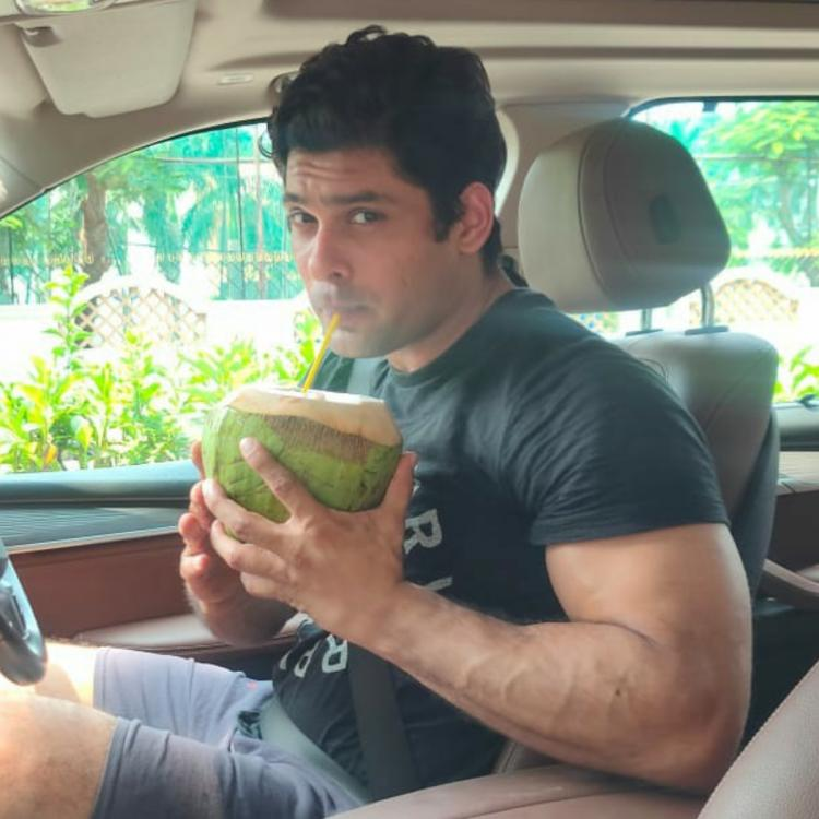 Sidharth Shukla sips coconut water as he relaxes inside his car