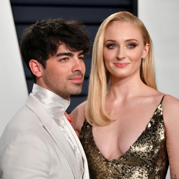 VIDEO: Joe Jonas kisses Sophie Turner & BITES his birthday cake as thousands of fans sing the birthday song