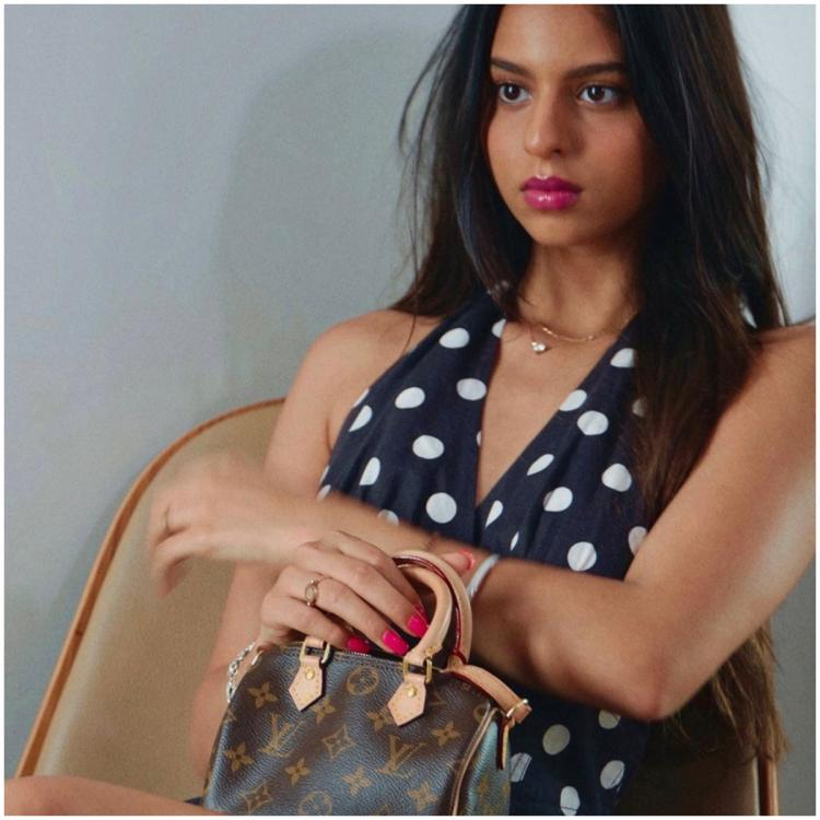 Suhana Khan shows she knows her luxury brands well as she plays dress up and poses with her 'baby Louis'