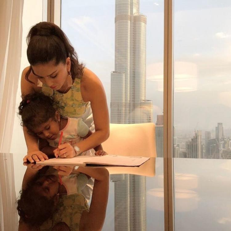 Sunny Leone helps her daughter Nisha with her homework while vacaying in Dubai; Check out the cute picture