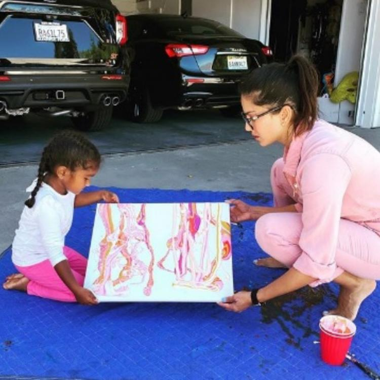 Sunny Leone and daughter Nisha work on a painting