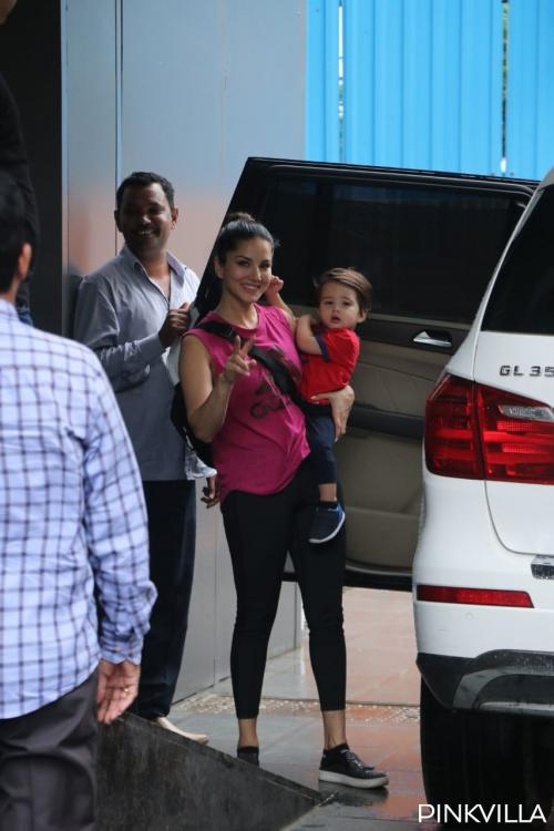 PHOTOS: Sunny Leone flashes her smile while Asher cuddles in her arms as they exit the playschool