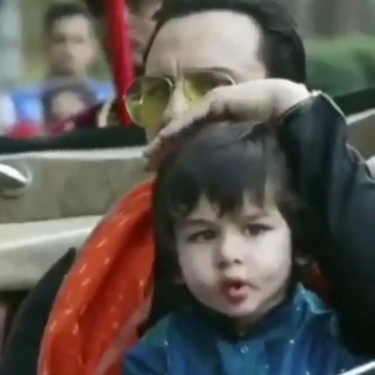Taimur Ali Khan enjoys a ride with dad Saif Ali Khan as the latter pats on his head in a throwback VIDEO